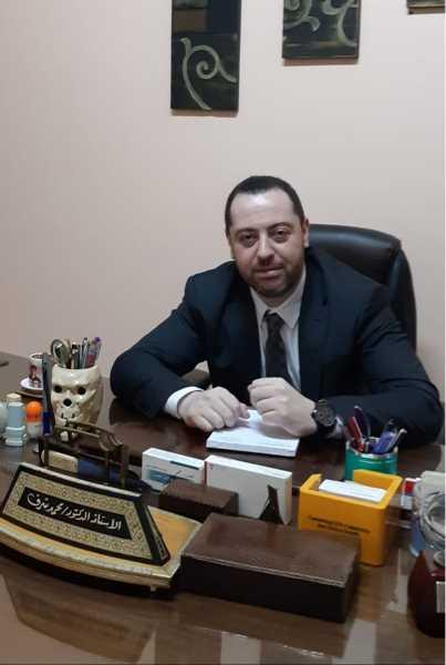 دكتور  محمد محمد شرف  طبيب امراض روماتيزميه ، مناعه و امراض باطنيه القاهرة